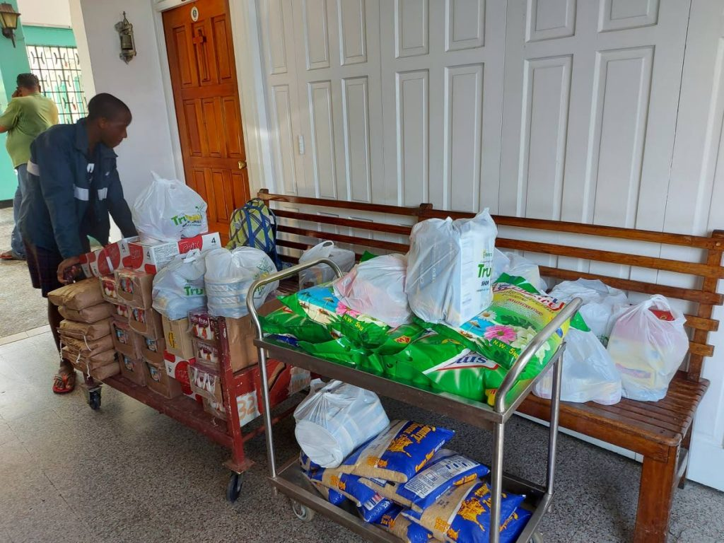 CHINESE DONATION: An employee at the Lady Hochoy Home moves a trolly of food items which were donated by Chinese ambassador Fang Qiu.  -