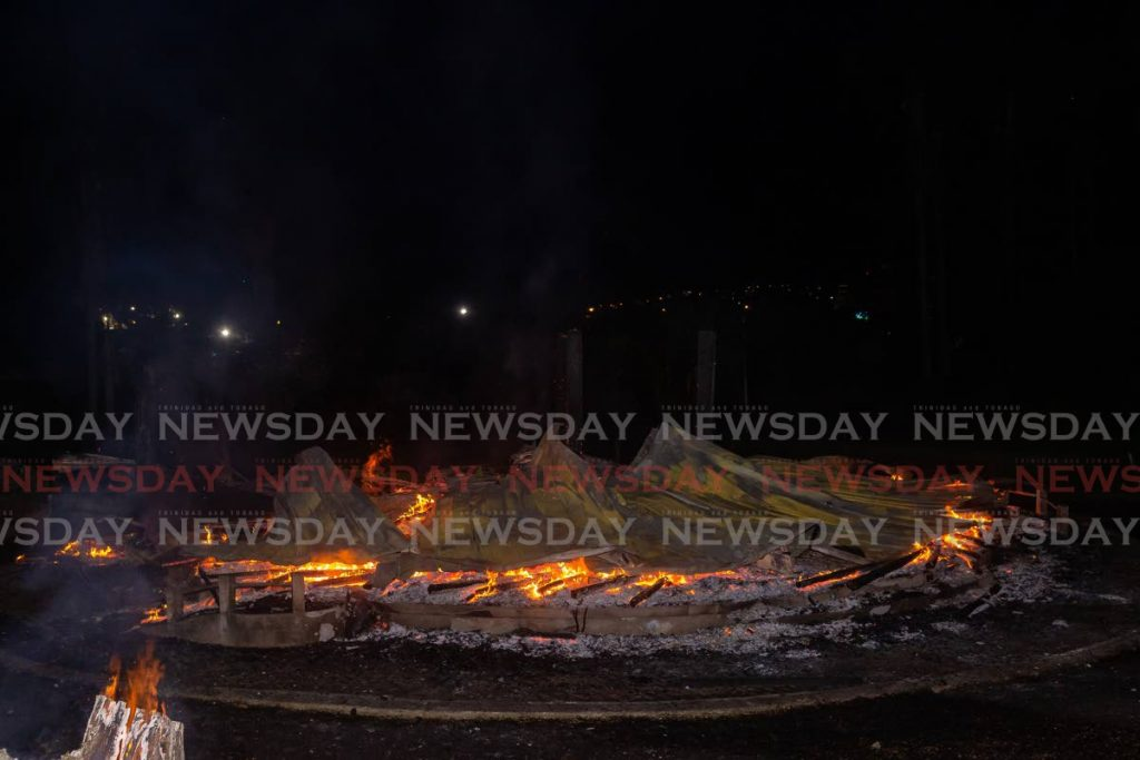 DESTROYED: The gazebo at the center of the Botanic Gardens, Scarborough, Tobago, was burnt to the ground on Wednesday night. Photo by David Reid -