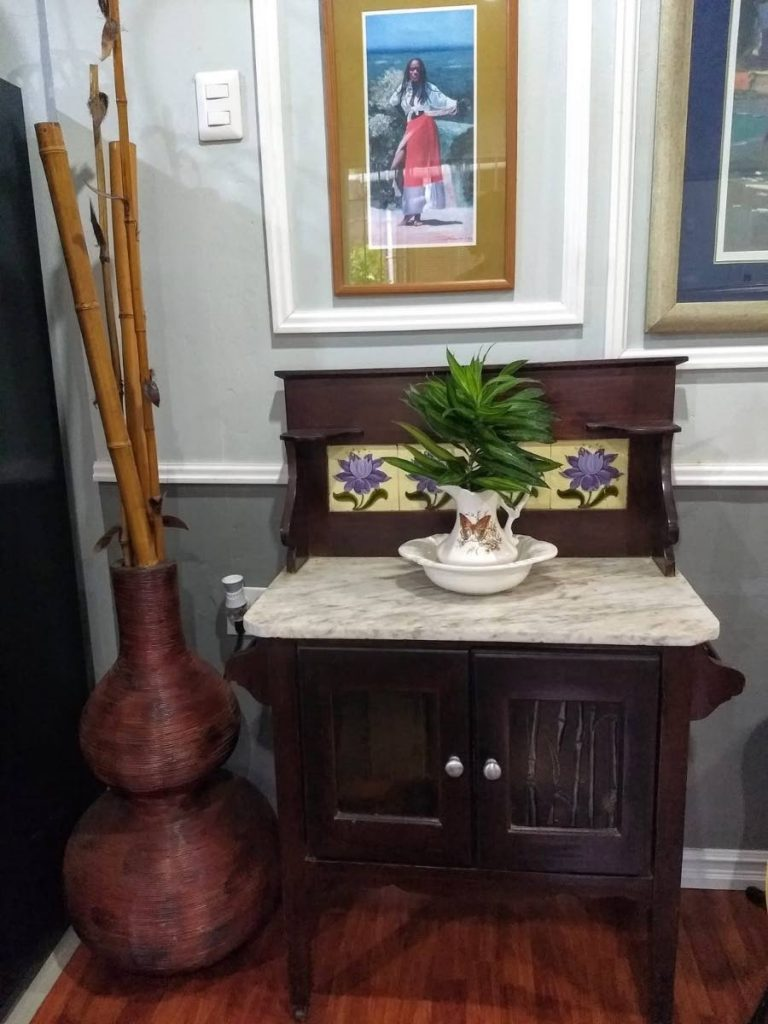 A refurbished antique marbletop wash stand complete with pitcher and basin. -