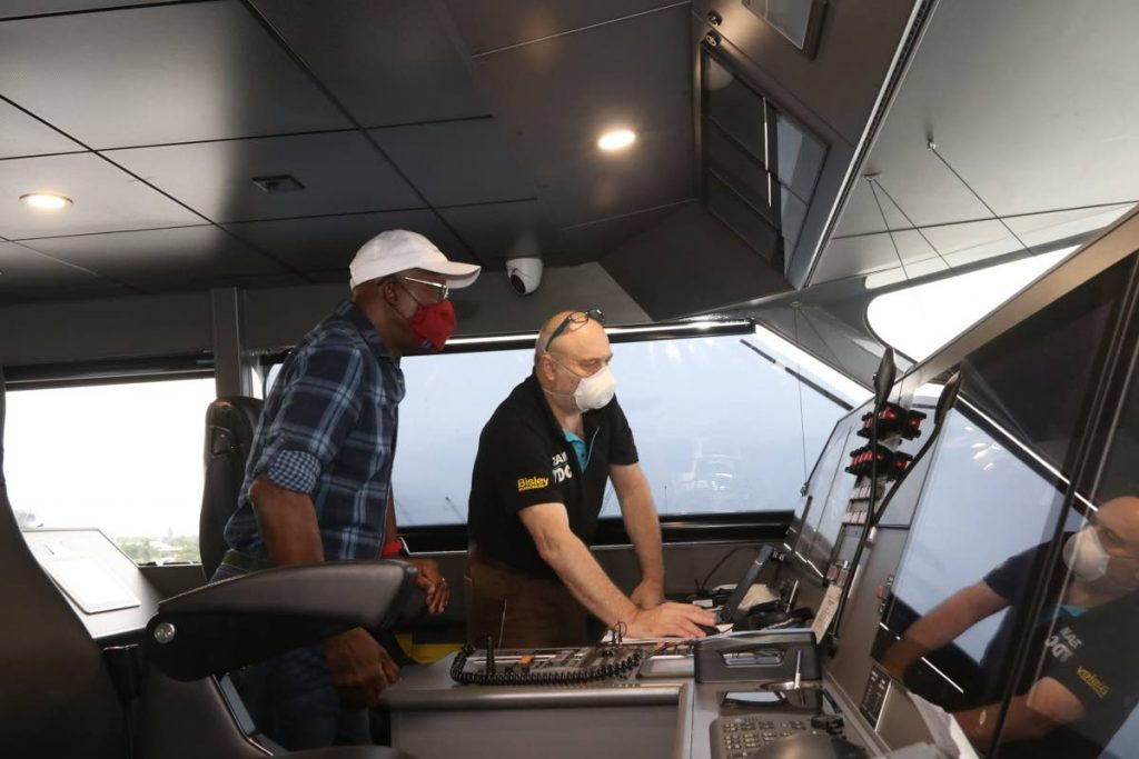 LIKE THIS: A crew member explains the vessel's navigation system with Dr Rowley in the control room.  - Photo courtesy OPM