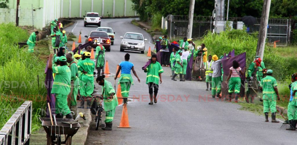 CEPEP workers clean along the Arima Old Road in D'Abadie in July 2016. - ROGER JACOB