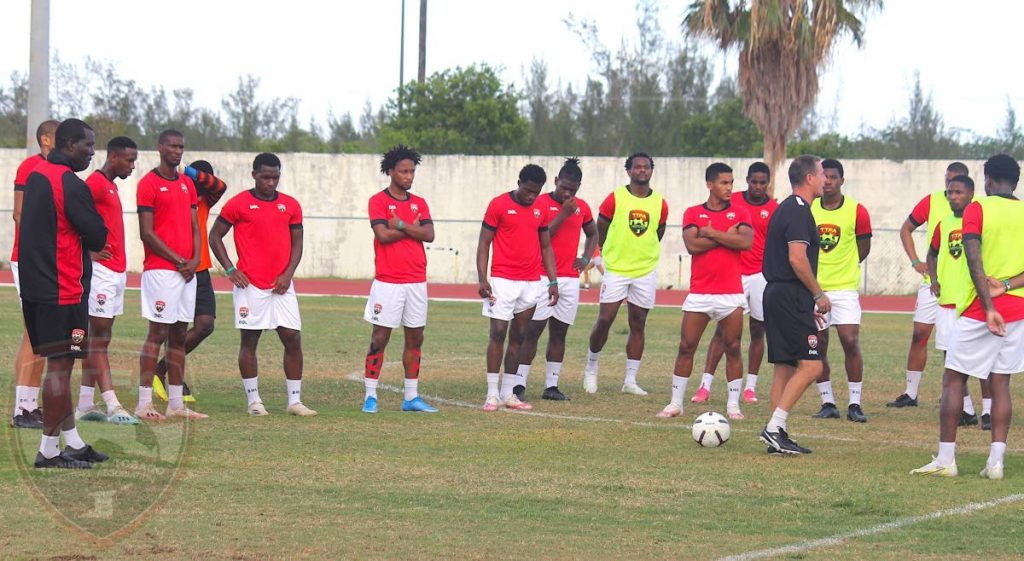 TT men's football team coach Terry Fenwick (fifth from right) speaks to his squad during a training session at Nassau, Bahamas on Thursday.  - TTFA Media