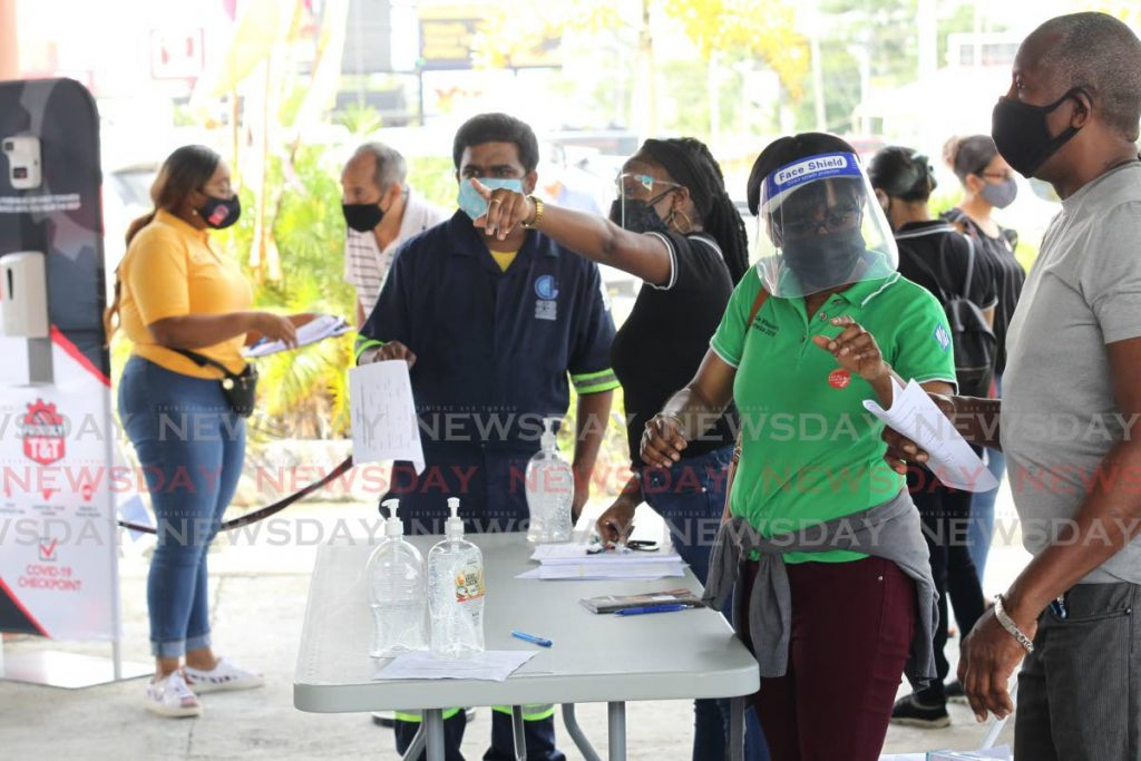 Trinidad and Tobago manufacturers association mass vaccine drive at the Divali Nagar site, Chaguanas, Volunteers assist employees of the sector. - Lincoln Holder