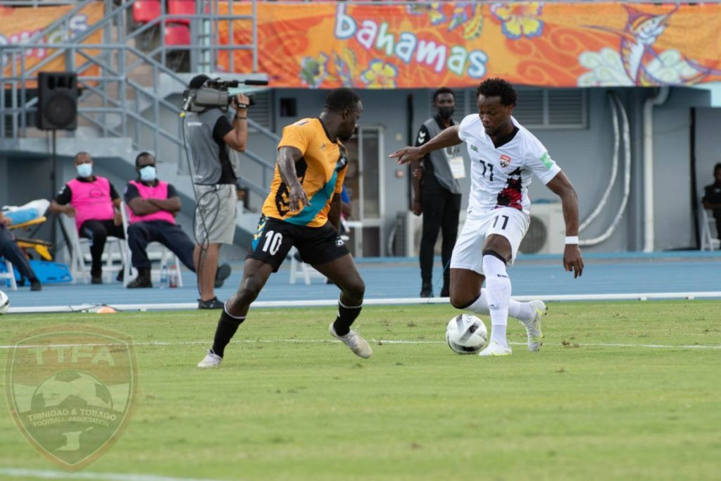 TT winger Levi Garcia (right) attempts to get past Bahamas' Lesly St Fleur during the teams' 2022 FIFA World Cup Concacaf Zone qualifier at the Thomas Robinson Stadium, Nassau, Bahamas on June 5, 2021. PHOTO COURTESY TT FOOTBALL ASSOCIATION. -