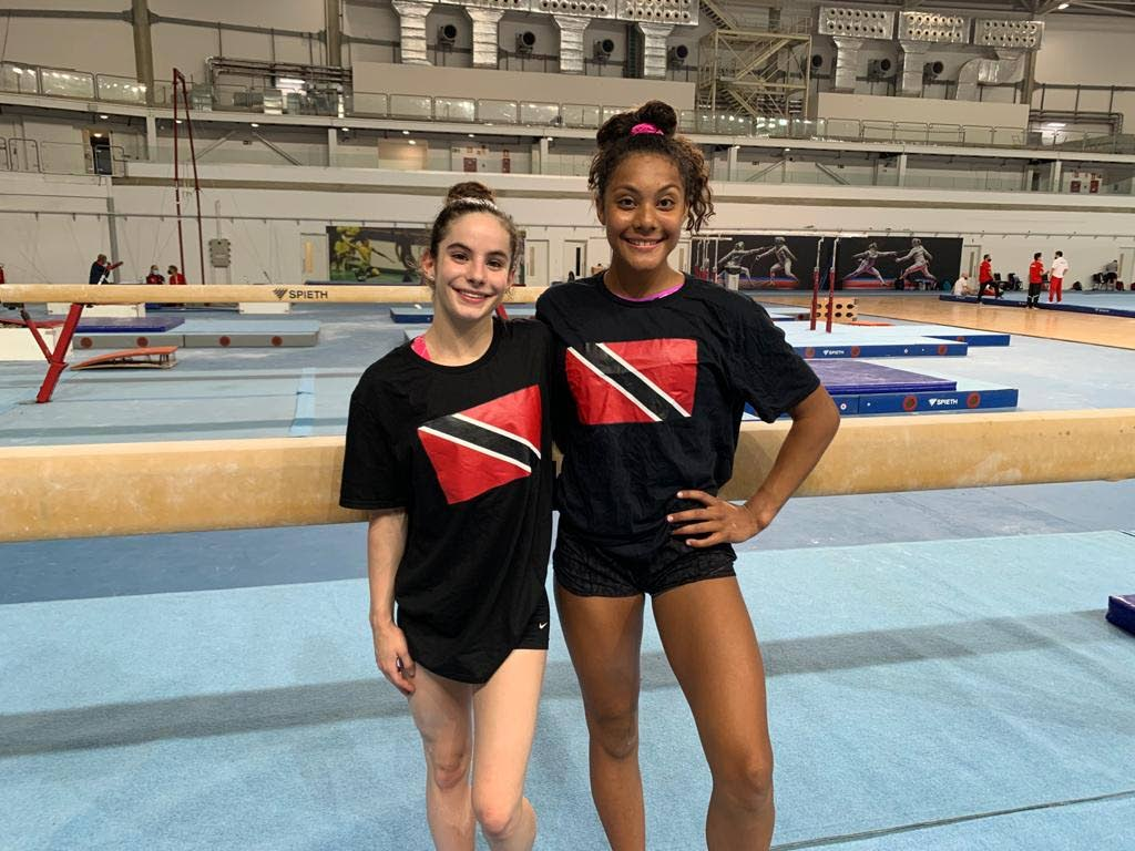 TT gymnasts Maria Ferguson, left, and Annalise Newman-Achee at the Senior Pan American Gymnastics Championships in Brazil over the weekend. -