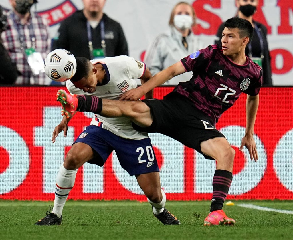 Mexico's Hirving Lozano (22) and United States' Reggie Cannon (20) go after the ball during extra time in the Concacaf Nations League  championship match, on Sunday, in Denver.  AP Photo -