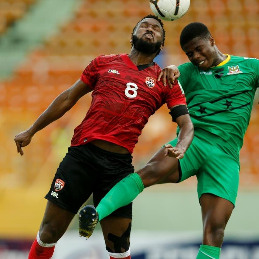 Khaleem Hyland (L) heads the ball in the 2022 Fifa World Cup Concacaf Zone qualifier against St Kitts/Nevis, at the Felix Sanchez Stadium, Dominican Republic, on Tuesday. TT won the match 2-0. - via TTFA Media