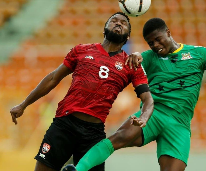 Khaleem Hyland (L) heads the ball in the 2022 Fifa World Cup Concacaf Zone qualifier against St Kitts/Nevis, at the Felix Sanchez Stadium, Dominican Republic, on Tuesday. Photo source TTFA Media