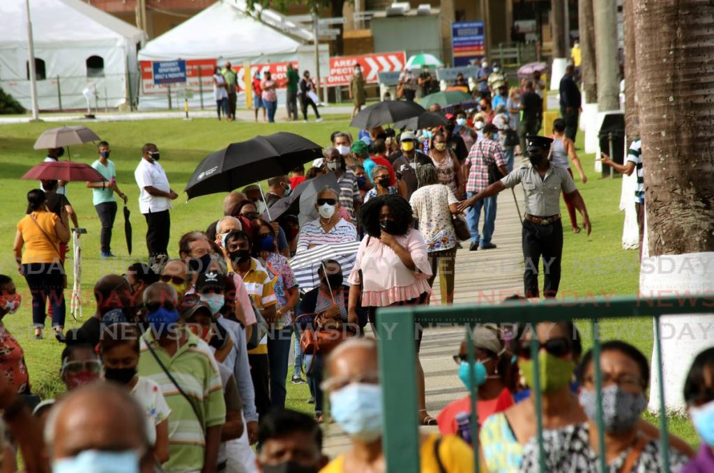 OH GOODNESS: A massive crowd of people outside the St Joseph Health Centre on Wednesday morning all waiting to get vaccinated. PHOTO BY SUREASH CHOLAI
