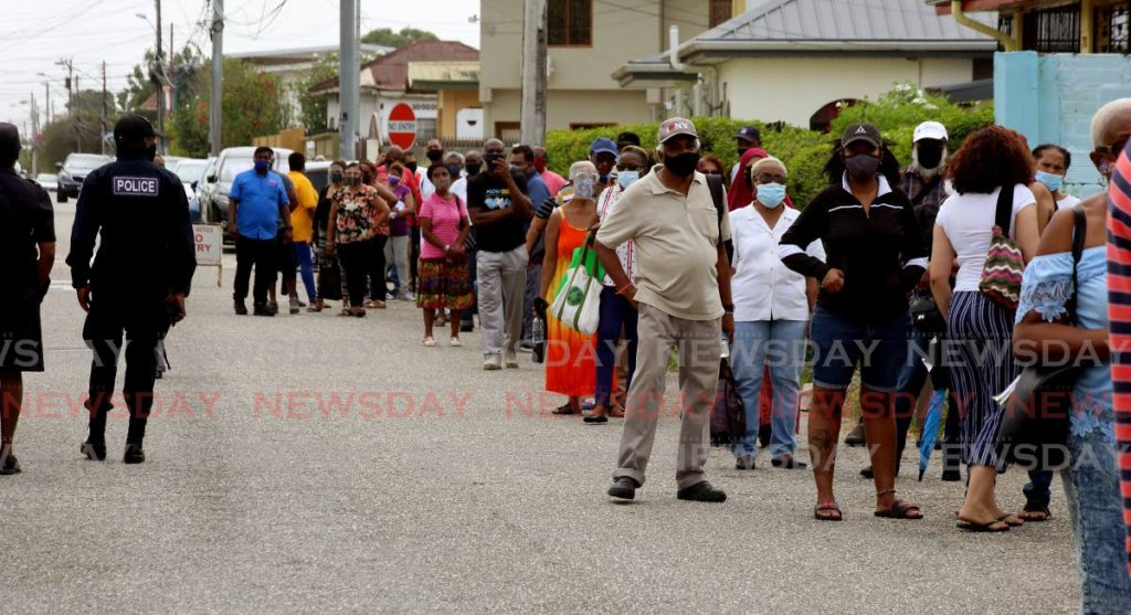 Police were needed Wednesday to control the crowd at the Barataria Health Centre. Photo by Sureash Cholai - SUREASH CHOLAI