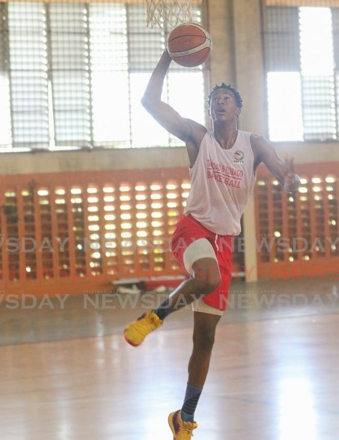 Jael Lewis, ranked first in TT's under-23 3x3 players, elevates for a dunk during a practice session. -