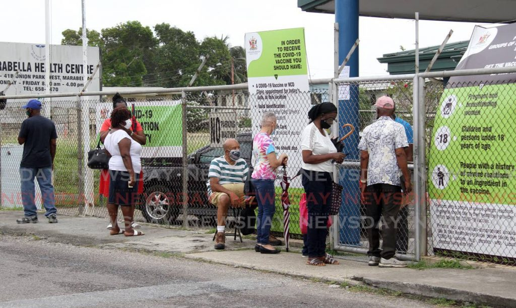 Just a few people remain outside the Marabella Health Centre on Thursday morning. Photo by Angelo Marcelle