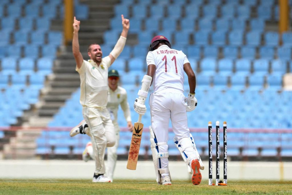 Kraigg Brathwaite (right) of West Indies is bowled by South Africa fast bowler Anrich Nortje (left) of South Africa during day 1 of the 1st Test between South Africa and West Indies at the Darren Sammy Cricket Ground, Gros Islet, St Lucia, on Thursday. (AFP PHOTO) -