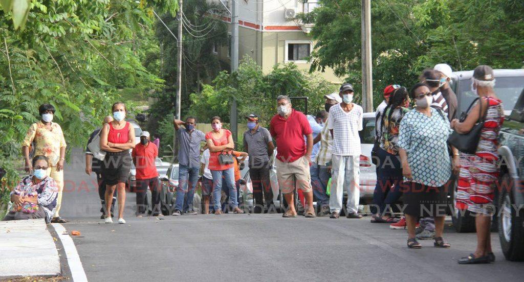 The tail end of the line of citizens waiting outside the La Romaine Health Centre on Friday to get their first dose of the covid19 vaccine.   - Angelo Marcelle