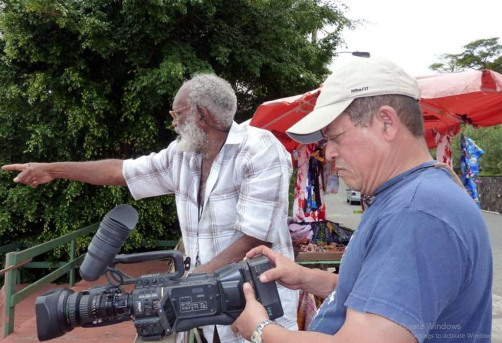 Timmy Mora, right, during the filming of the regional parliament series in St Lucia. -