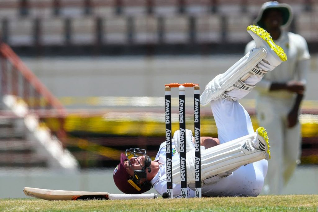 West Indies batsman Joshua de Silva grimaces in pain after being hit on the arm by South Africa fast bowler Kagiso Rabada during the third day of the 1st Test between South Africa and West Indies at the Darren Sammy Cricket Ground, Gros Islet, St Lucia, on Saturday. (AFP PHOTO)