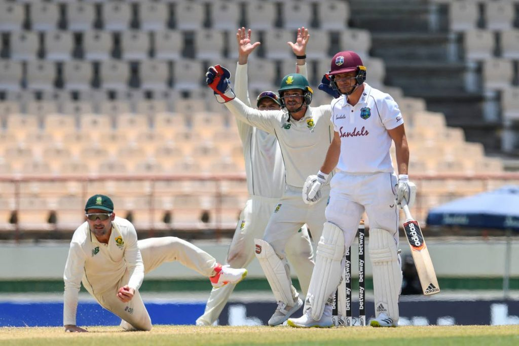 Dean Elgar (L) and Quinton de Kock (2R) of South Africa appeal for catch to dismiss Joshua de Silva (R) of West Indies during day 3 of the 1st Test between South Africa and West Indies at Darren Sammy Cricket Ground, Gros Islet, Saint Lucia, on Saturday. - (AFP PHOTO)