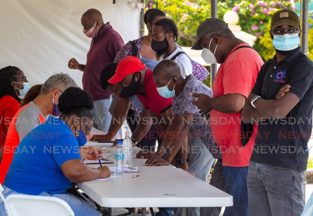 Flashback: Construction workers, right, are pre-screened at the Magdalena Grand Beach and Golf Resort car park ahead of receiving their covid19 vaccines last week. - DAVID REID