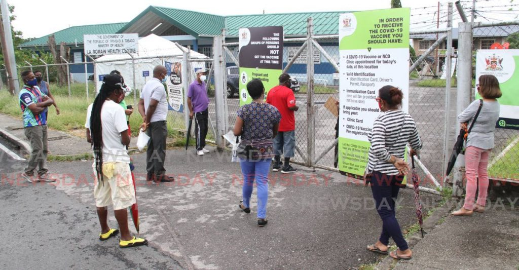 A few people hoping to get covid19 vaccines were left outside the La Romain Health Centre on Monday. - Angelo Marcelle
