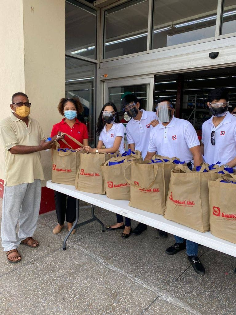 Dansteel staff with some of the hampers which have been donated to families in need in south Trinidad.   PHOTO COURTESY DANSTEEL LTD. -