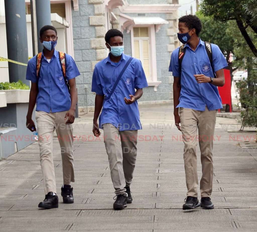 Students from Queen's Royal College walk down  Abercromby Street in Port of Spain after doing their CSEC exams on Monday. - Photo by Sureash Cholai