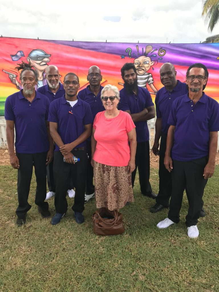 Wishing for Wings founder Debbie Jacob, centre, with members of the Carrera Prison debate team. -
