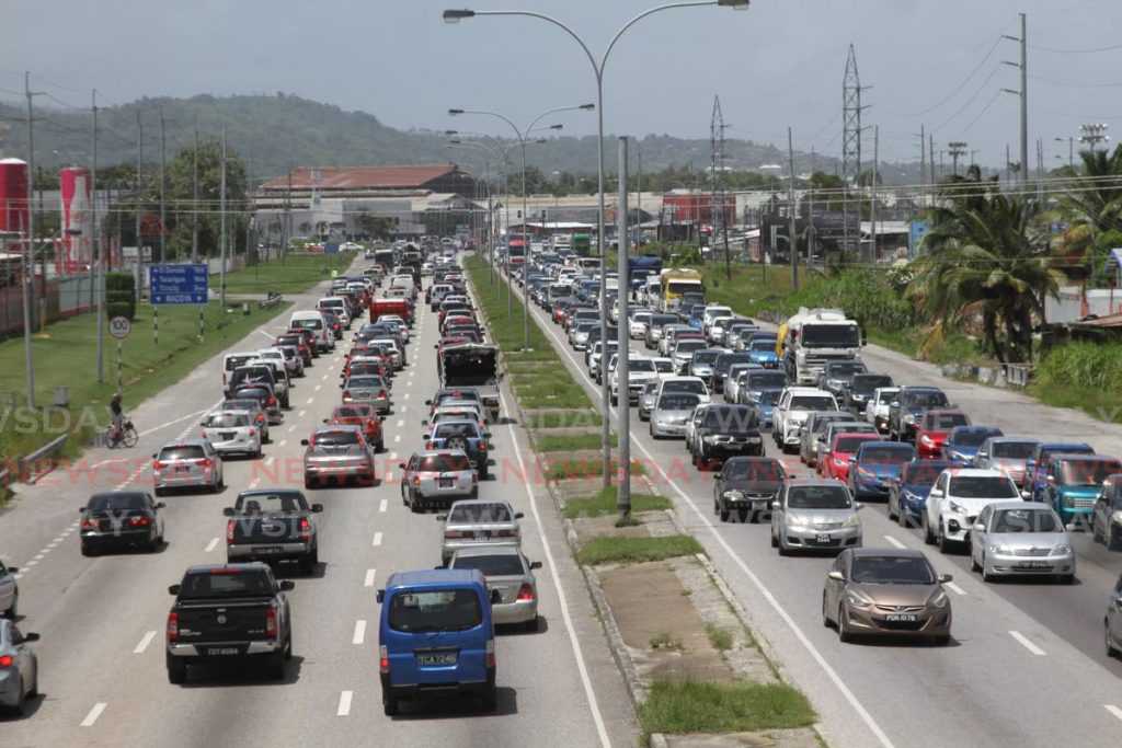 TRAFFIC: With the level of traffic on the Churchill Roosevelt Highway on Friday, one could easily think it was business as usual in TT rather than the country being in a state of emergency because of the covid19 pandemic. PHOTO BY  Marvin Hamilton