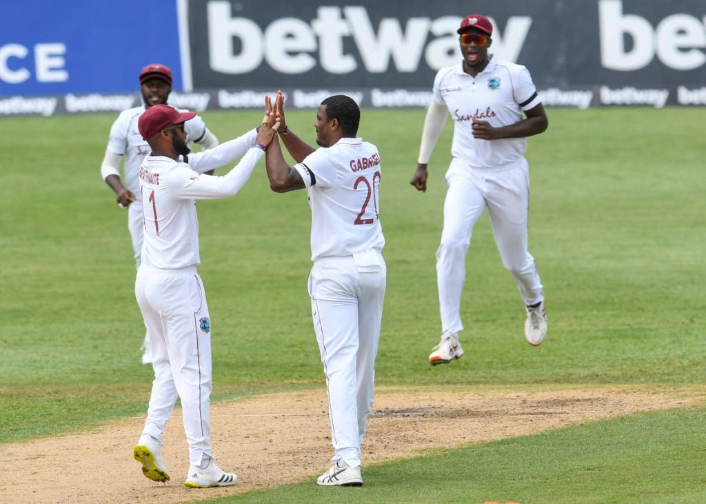 Kraigg Brathwaite (L) and Shannon Gabriel (2R) of West Indies celebrate the dismissal of Aiden Markram of South Africa during day 1 of the 2nd Test at Darren Sammy Cricket Ground, Gros Islet, Saint Lucia, on Friday. - (AFP PHOTO)