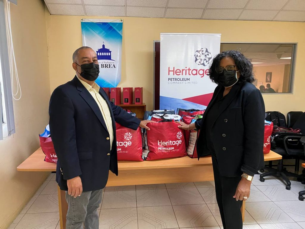La Brea MP Stephen Mc Clashie receives food hampers from  Heritage Petroleum's CEO Arlene Chow. -