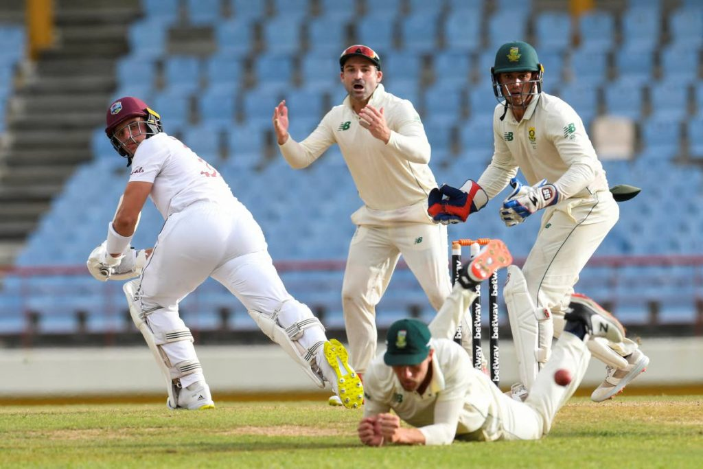 Dean Elgar (C) and Quinton de Kock (R) of South Africa watch as Joshua de Silva's (L) of West Indies ball is dropped during day 2 of the 2nd Test between South Africa and West Indies at Darren Sammy Cricket Ground, Gros Islet, Saint Lucia, on Saturday. - (AFP PHOTO)