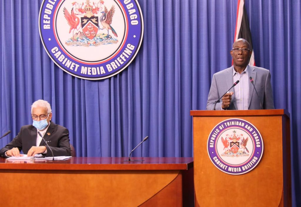 Prime Minister Dr Keith Rowley, right, and Health Minister Terrence Deyalsingh at Saturday's press briefing, at the Diplomatic Centre, St Ann's. - Photo courtesy OPM