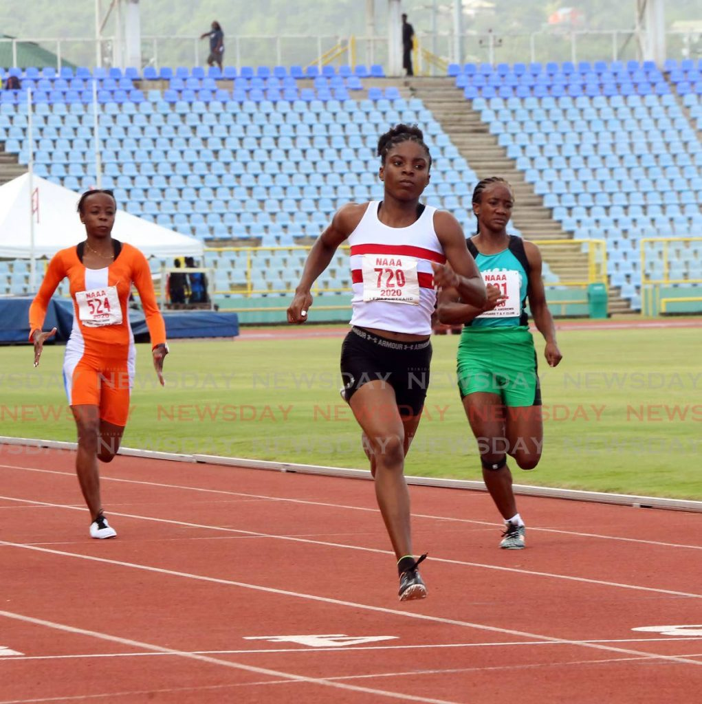 Leah Bertrand(C), of Simplex, wins the women's 100m, during Day 1 of the NAAA Olympic qualifiers, on Monday, at the Hasely Crawford Stadium, Mucurapo.  - SUREASH CHOLAI