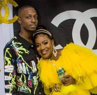 Shaddai Simon takes a picture with his mother Petula Skeete, for his mother's birthday party in March.   PHOTO COURTESY SIMON'S RELATIVES