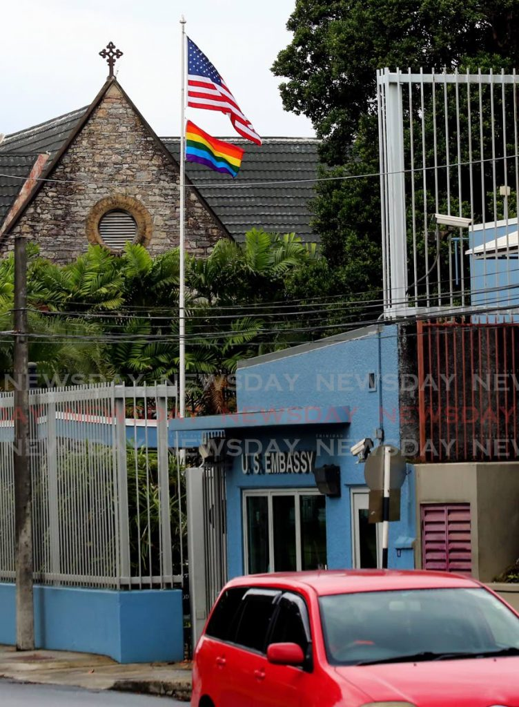A rainbow flag flies alongside the US national flag outside the US Embassy in Port of Spain on Saturday. The rainbow flag was raised to celebrate Pride month and the LGBTQI+ movement. - PHOTO BY SUREASH CHOLAI