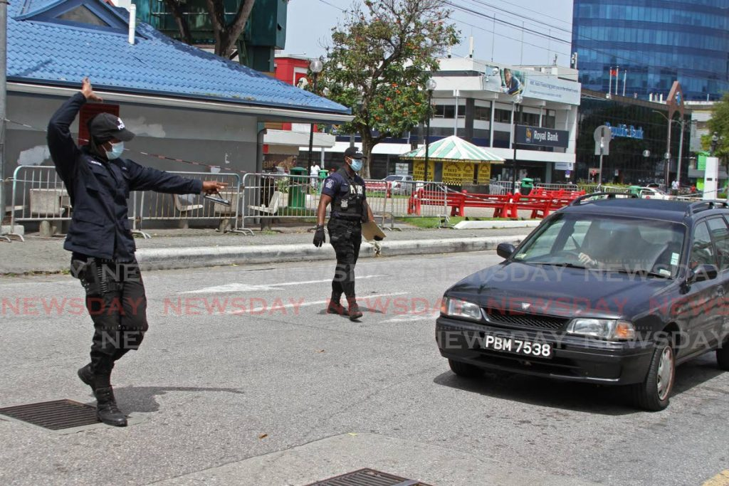 In this June 29 file photo, police officers conduct a road traffic exercise on Independence Square in Port of Spain. Photo by Marvin Hamilton