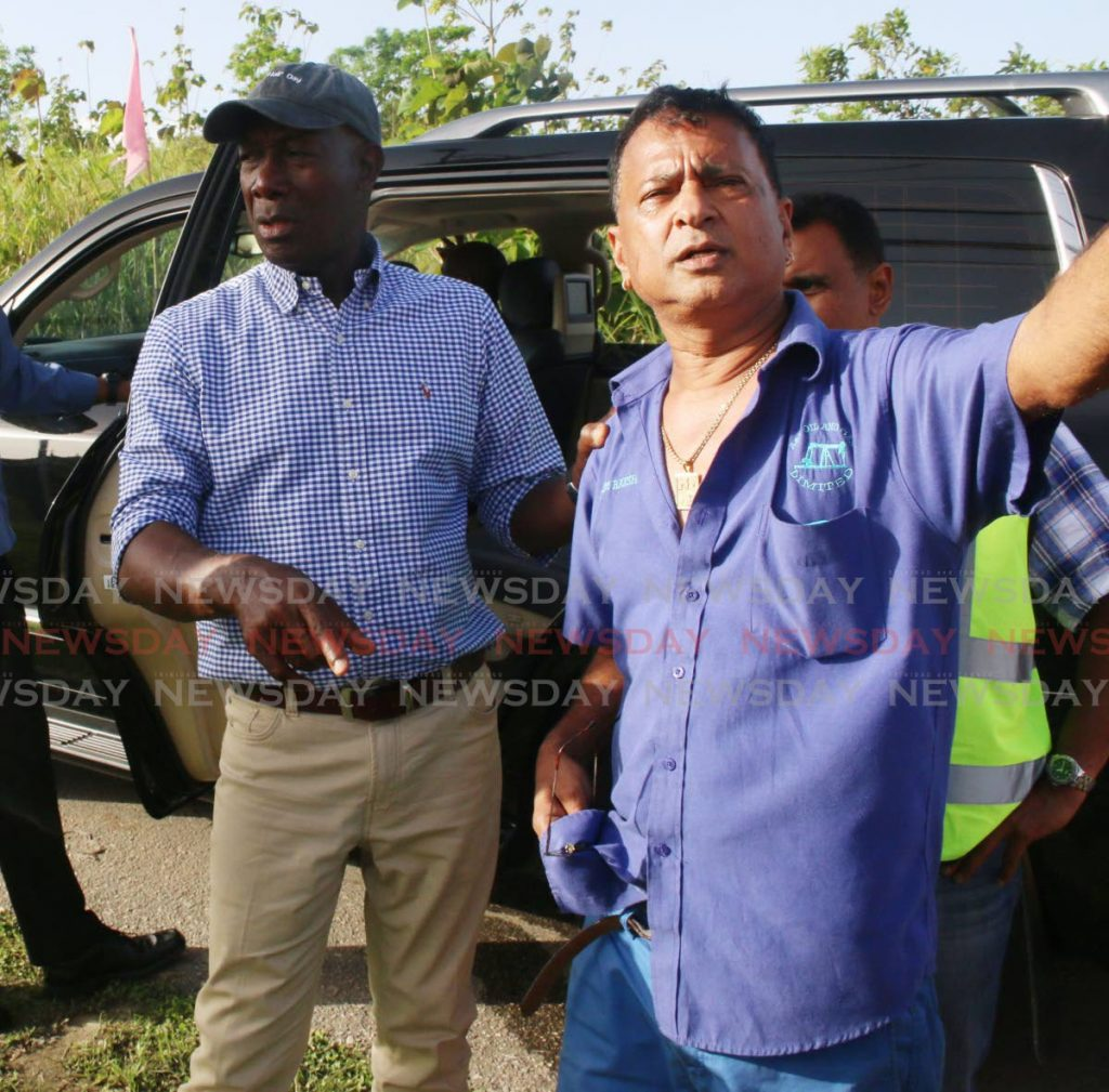 In this 2017 file photo, A&V Oil owner Nazim Baksh, right,  with Prime Minister Dr Keith Rowley during a tour of flood affected areas in Penal.  -