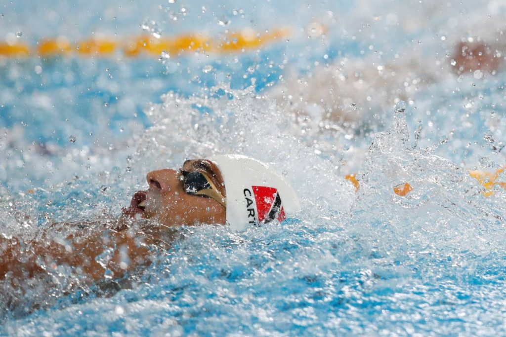In this August 8, 2019 file photo, Dylan Carter of Trinidad and Tobago competes to earn the bronze in the men's 100-metre backstroke at the Pan American Games in Lima, Peru. (AP PHOTO) -