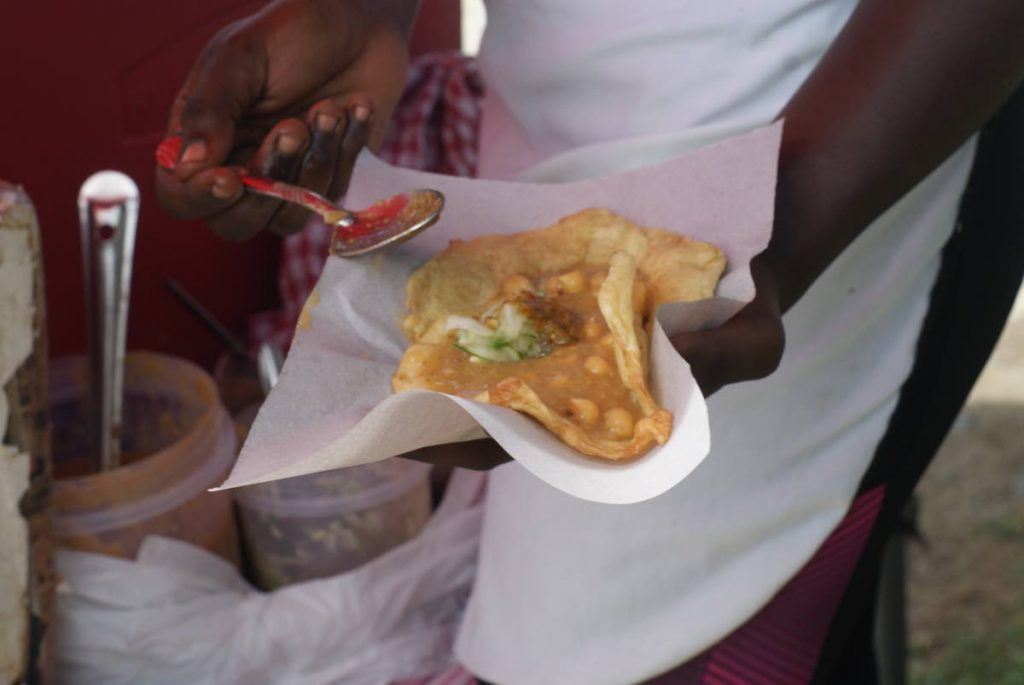People took to social media to respond to negative comments about doubles posted under a May 27 BBC article on the street food. -
