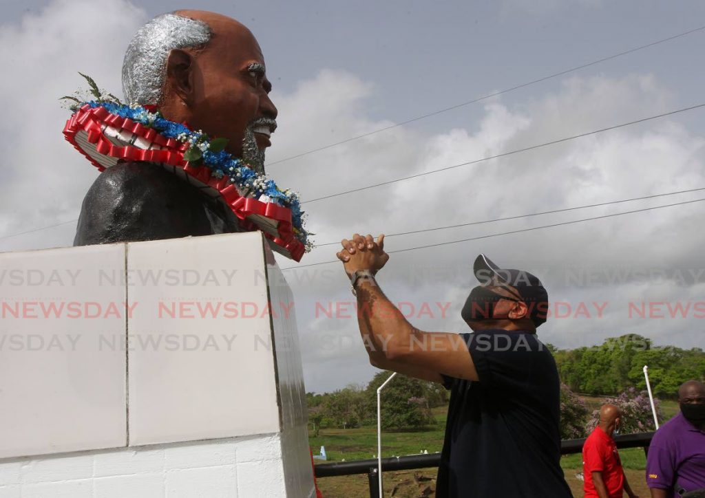 In this June 2020 file photo, Ancel Roget, president general of the Oilfield Workers Trade Union wreaths a bust of Tubal Uriah Butler, founder of the labour movement in TT, at the Fyzabad cemetery at the start of Labour Day celebrations. As the workforce continues to change and evolve, trade unions will have to adapt if they are to remain relevant. - L Holder