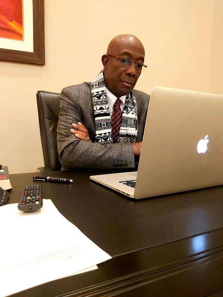 Prime Minister Dr Keith Rowley on a conference call in March. Photo courtesy Dr Rowley's Facebook page -