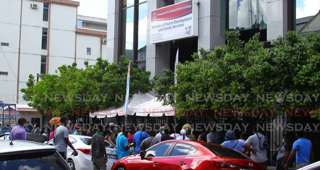 Scores of people line up outside the Ministry of Social Development on St Vincent Street, Port of Spain to apply for relief grants on October 21, 2020.   - File photo/Roger Jacob