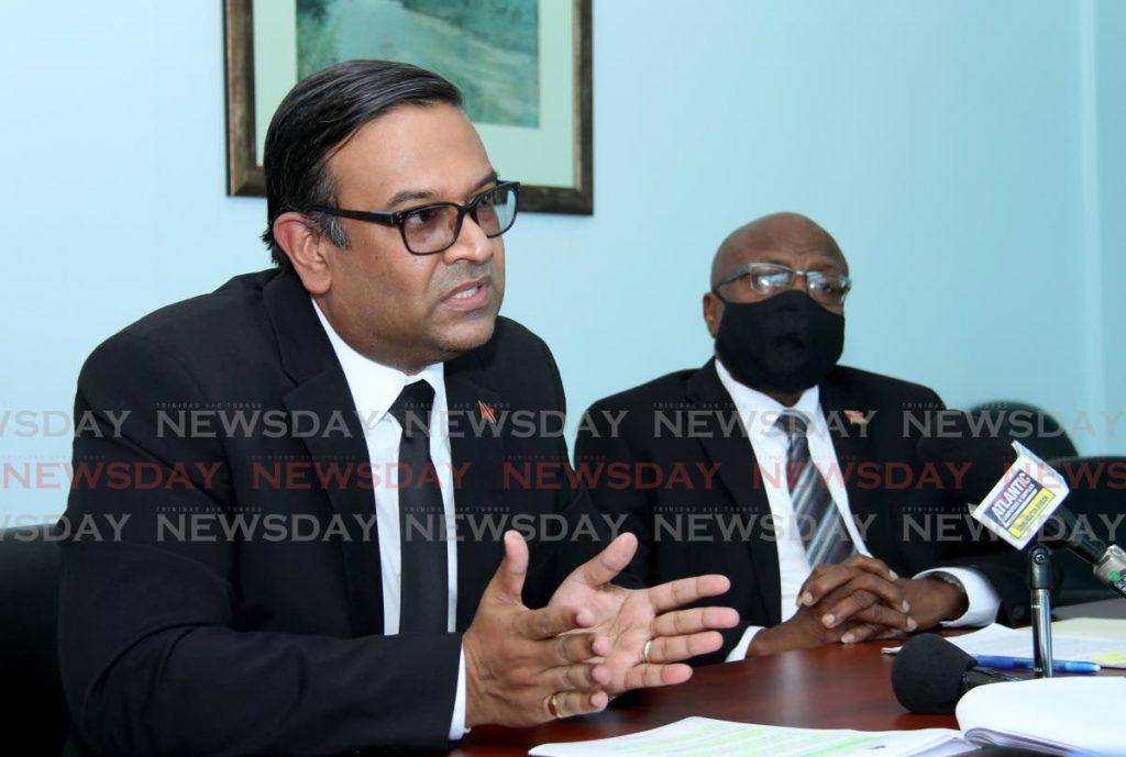 Member of Parliament for Caroni East Dr Rishad Seecheran, left, speaks during a press conference at the Office of the Opposition on Charles Street, Port of Spain. Looking on is Member of Parliament for Naparima Rodney Charles. - Photo by Ayanna Kinsale