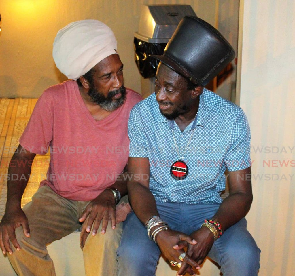 """FILE PHOTO: Lutalo """"Brother Resistance"""" Masimba, right, in deep conversation with Michael Alfonso back in December 2016. Masimba died on Tuesday. -"""