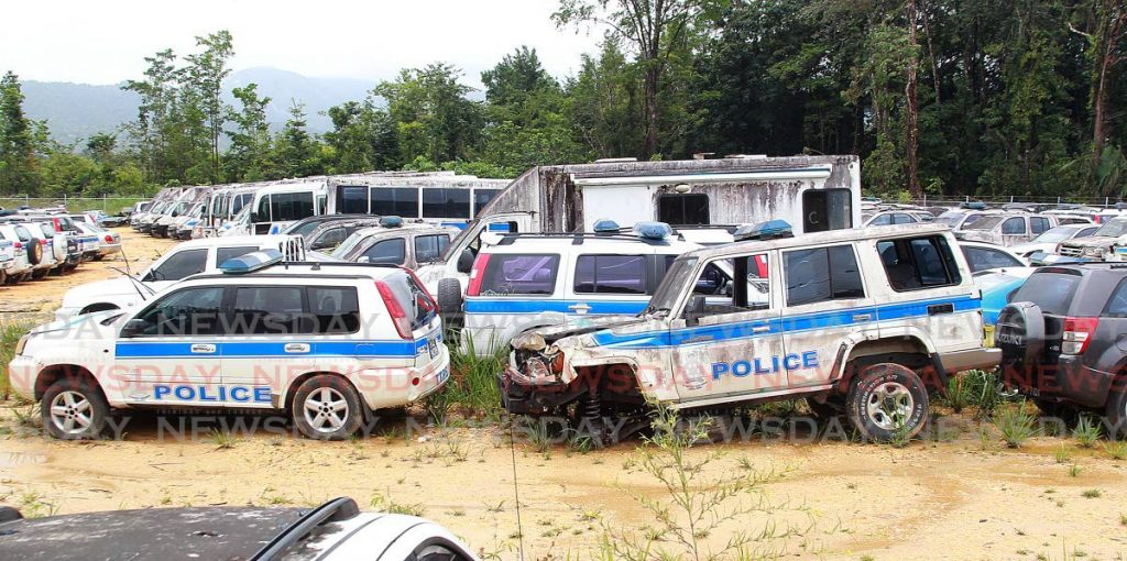 Some of the derelict police vehicles stored at the Cumuto impound lot.  - PHOTO BY ROGER JACOB