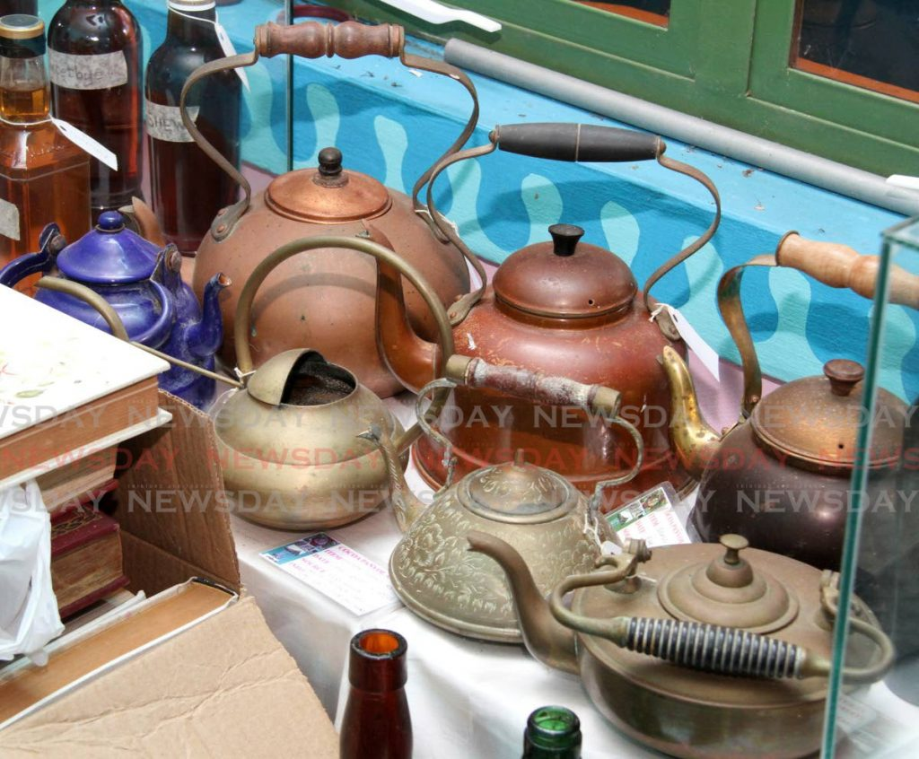 Teapots from the late 1800s at the Cocoa Panyol Museum.  - Photo by Angelo Marcelle