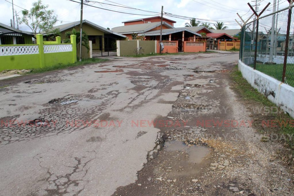 LOOK AT THIS ROAD: Tasker Avenue in Cashew Gardens, Edinburgh - one of the many roads in that area which is in a deplorable state. PHOTO BY ANGELO MARCELLE  -