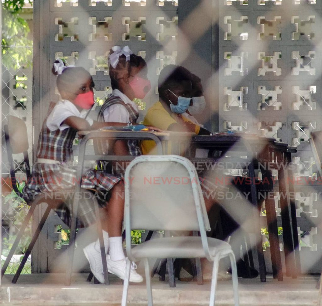 Pupils of the Valencia South Government Primary School, sit awaiting the start of the Secondary Entrance Assessment examinations in Valencia last Wednesday. - Photo by Roger Jacob