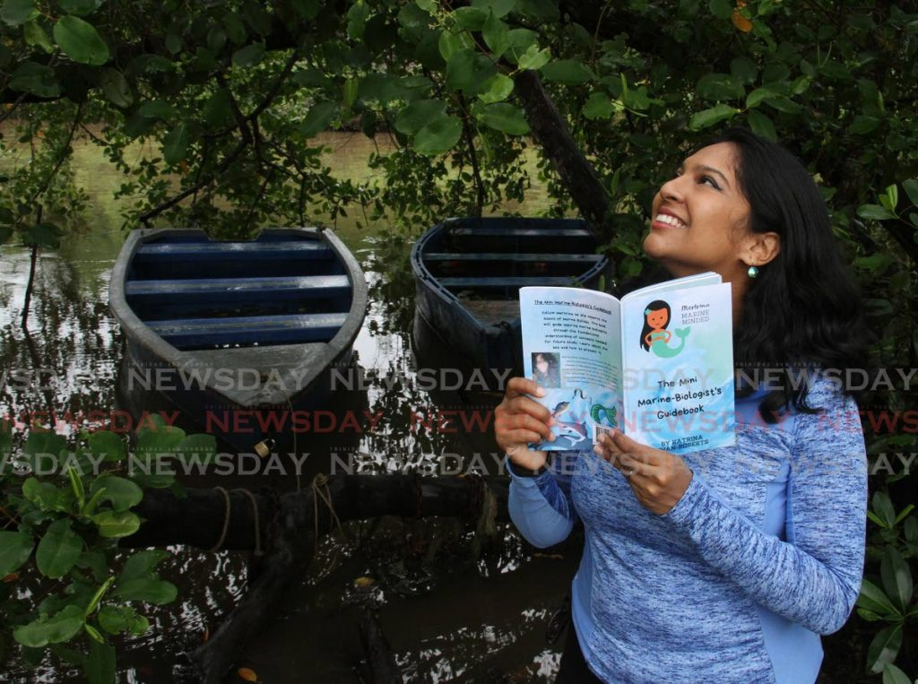 Marine biologist Katrina Khan-Roberts, author of Mertrina Marine Minded – The Mini Marine Biologist's Guidebook, says the book teaches children about marine life. - Photo by Angelo Marcelle