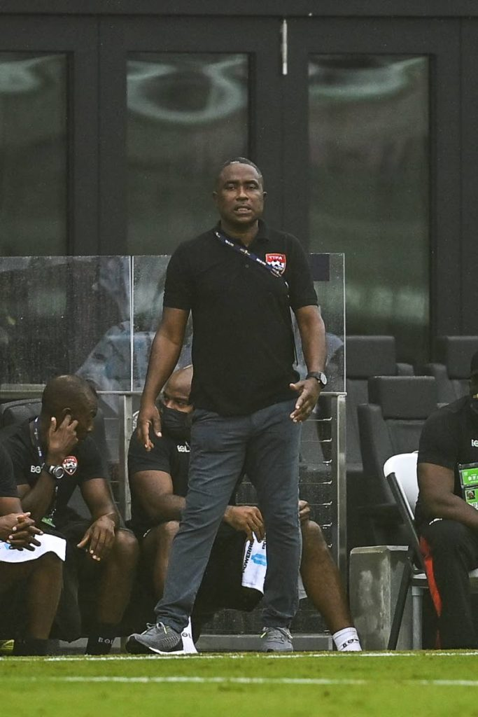 In this July 6 file photo, TT coach Angus Eve gestures from the sidelines during the Gold Cup qualification match against French Guiana at the DRV PNK Stadium in Fort Lauderdale, Florida. -