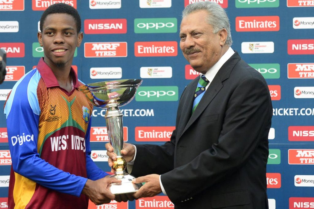 In this February 14, 2016 file photo, West Indies captain Shimron Hetmyer (left) receives the championship trophy from then-ICC president Zaheer Abbas during the presentation ceremony following the Under-19 World Cup cricket final between India and West Indies at the The Sher-e-Bangla National Cricket Stadium in Dhaka, Bangladesh. (AFP PHOTO) -